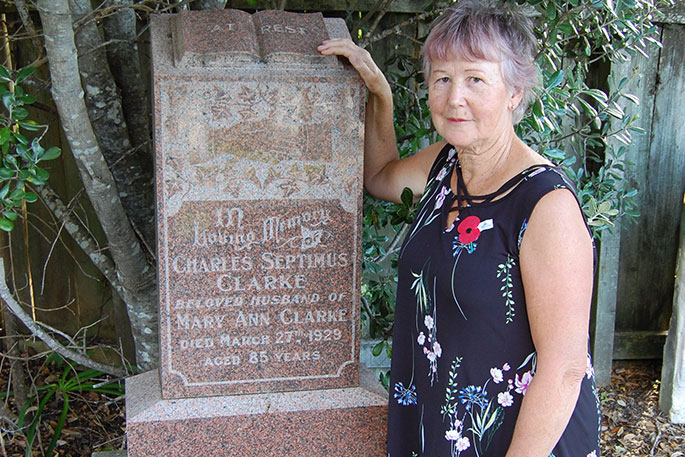 Grave. Leigh resident Jackie Atkins (nee Wyatt) at Charles Clarke's grave in Leigh Cemetery.  Jackie is a descendant of John Wyatt whose daughter Charles married. Jackie will speak at the 150th library celebrations on early settlement in Leigh.